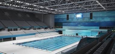 A completed Dagály Aquatic Center shows how massive the project was: a 19,000 m2 (204,500 square feet) footprint with two spectator areas each adding 2,000 m2 (21,500 square feet).