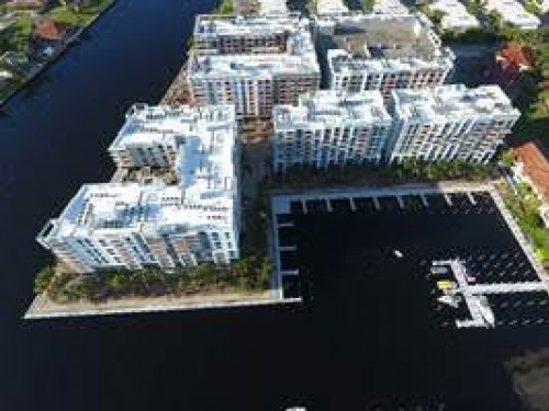 A bird's-eye-view shows the Modera Port Royale apartments and adjacent marina