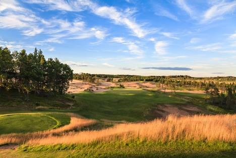 A view of the Sand Valley Golf Resort in Wisconsin shows the sand dunes and low-lying scrub vegetation that reflect the topography of great English courses.