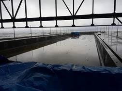 A wet winter day shows the view across the PENETRON-treated concrete pool structures out to the Black Sea